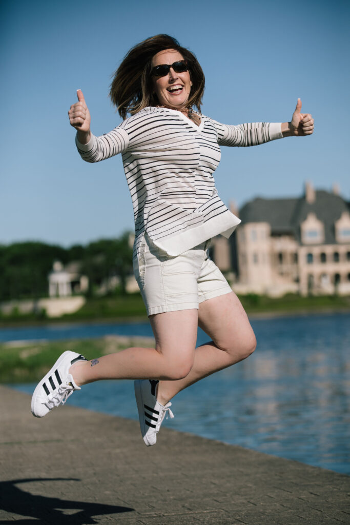 Woman Jumping for Joy in White Shorts