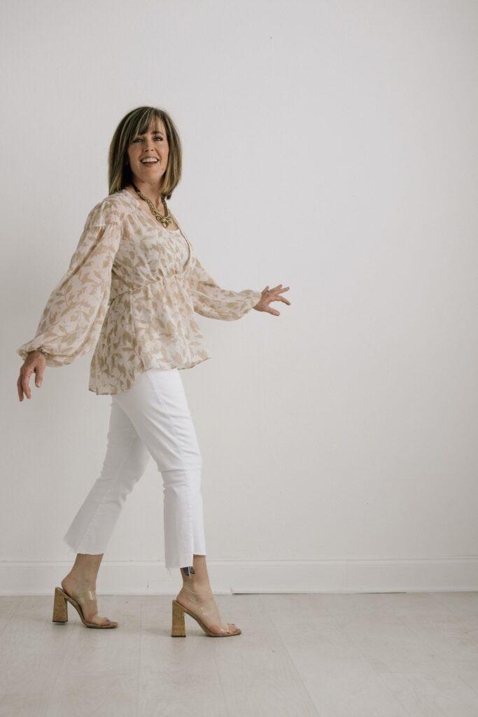 Pretty woman walking in white jeans