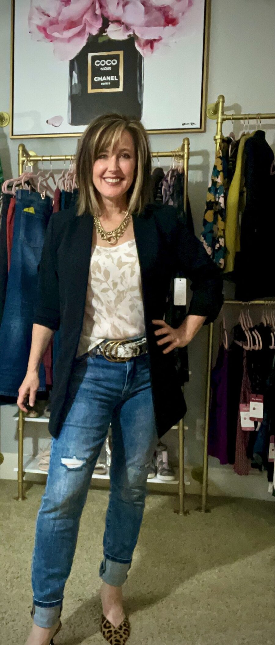 Pretty woman wearing black jacket in luxury clothing boutique