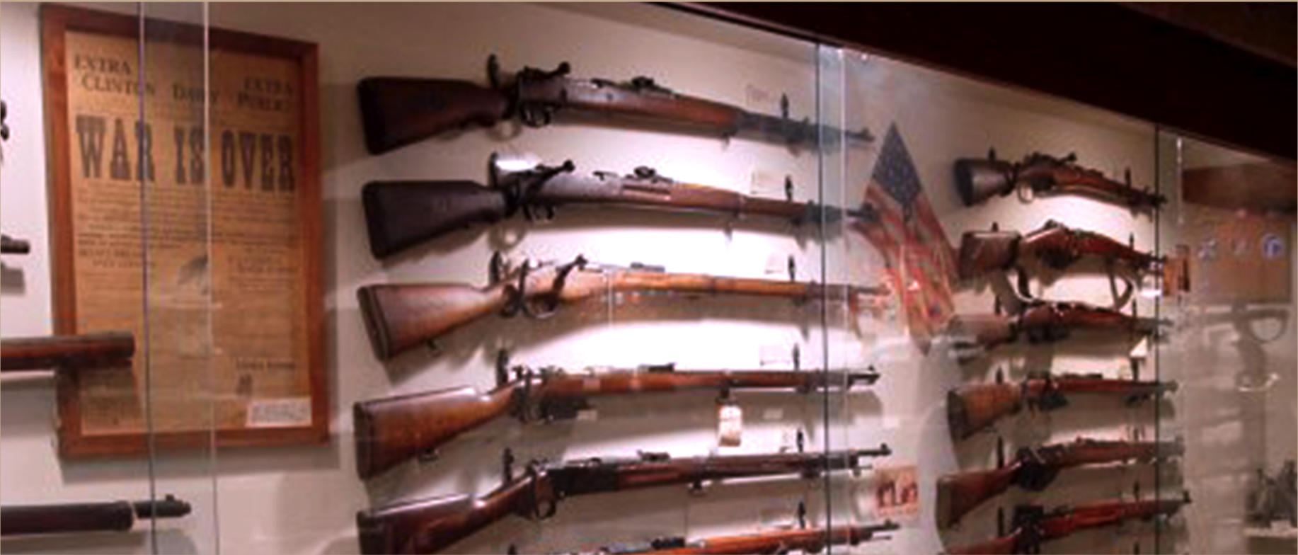Wall glass case with historical rifles