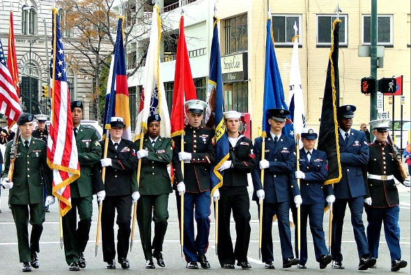 A color guard marches through downtown Denver to honor America's fallen veterans. | Photo by Jeffrey Beall