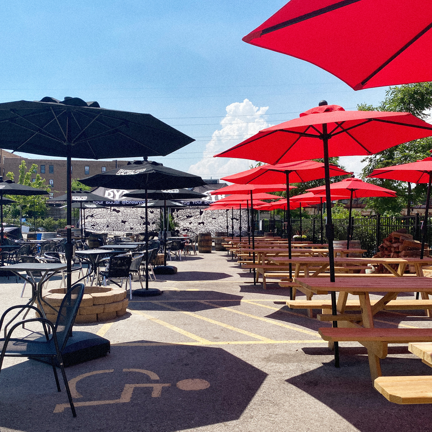 DBY patio with black and red umbrellas
