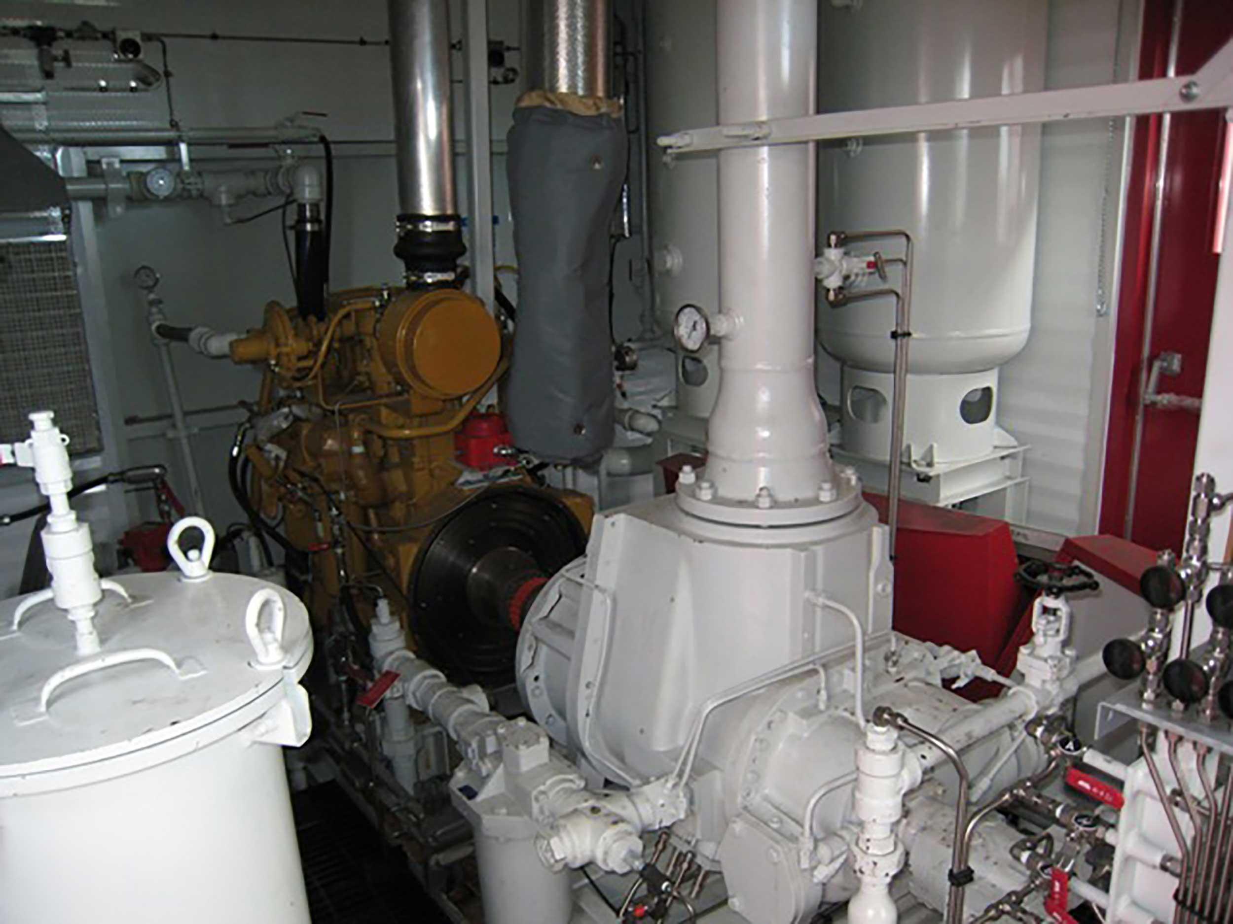 Interior 6 New / Never Used 95HP Caterpillar Vacuum Reciprocating Compressors For Sale in Alberta Canada