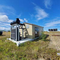 Used 550kW CAT G3512LE & Kato Generator Package for sale in Alberta Canada Behind the fence power surplus oilfield energy equipment 1