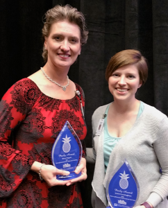 Mary Bogert and Jamie Cunningham accept their Pauly Awards from the Greater Knoxville Hospitality Association.