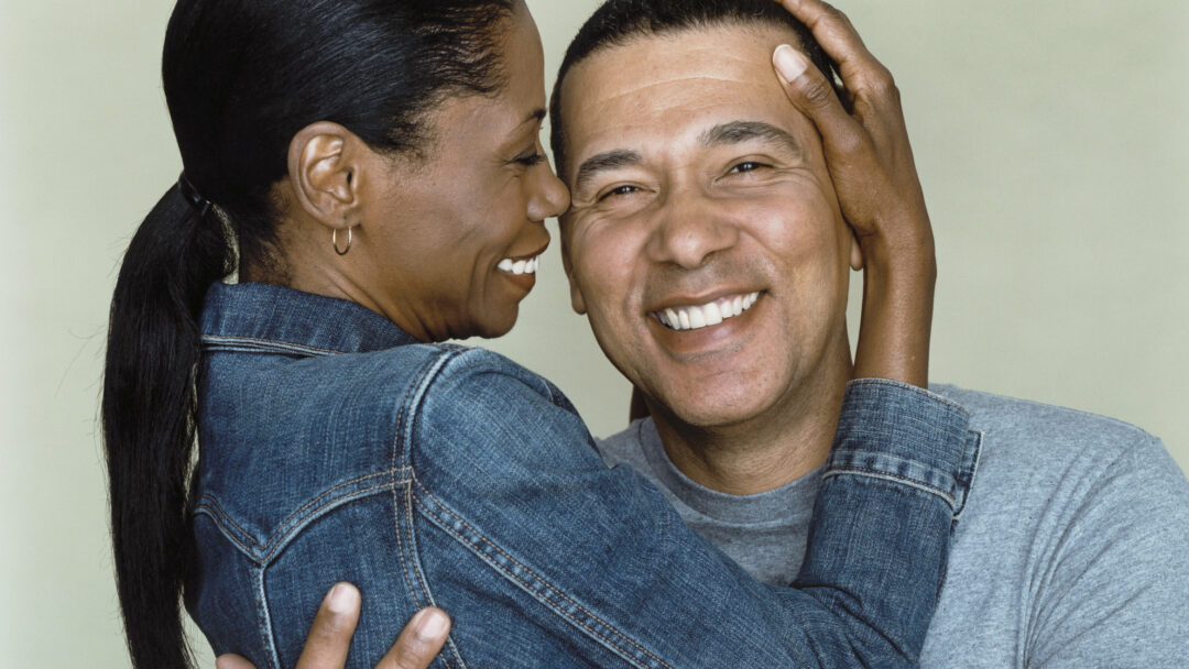 couple smiling about men's health clinic