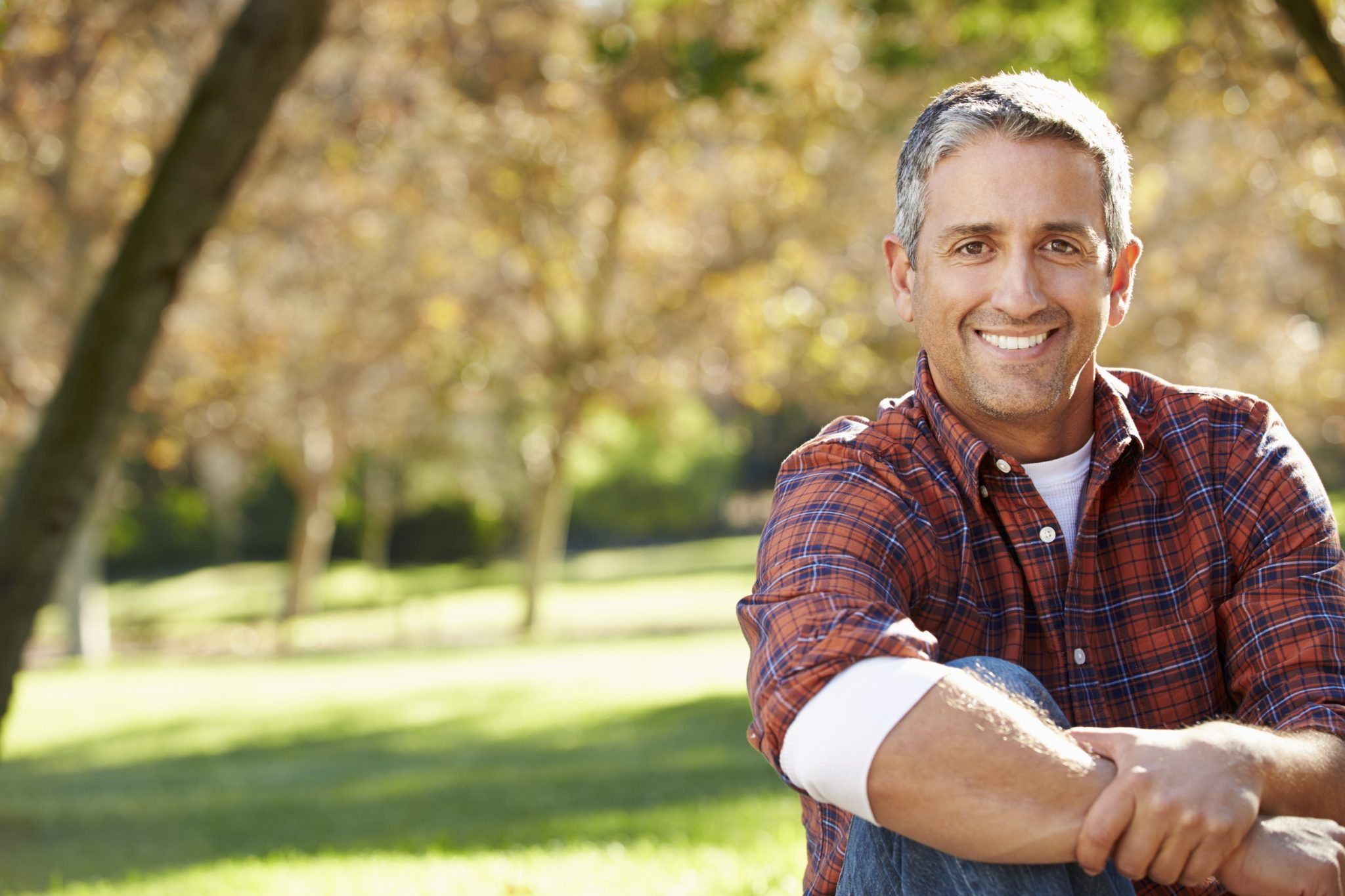 middle aged man smiling after Apex Men's Health Clinic treatment Omaha, NE