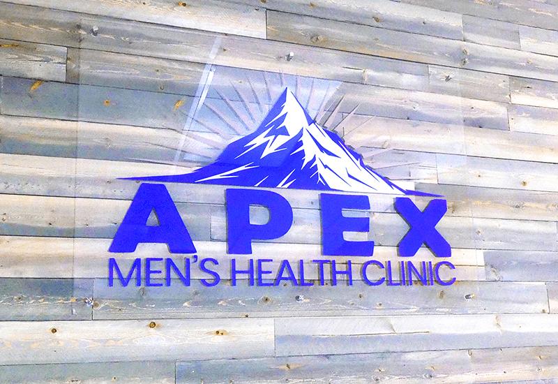 Apex Men's Health Clinic logo on wall of office, Omaha, NE