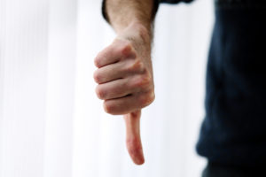 Thumbs down indicating client rejection