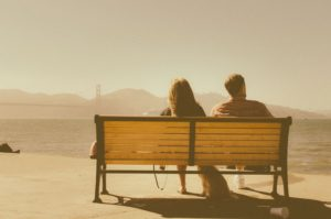 Photo: Couple Sitting on a Park Bench