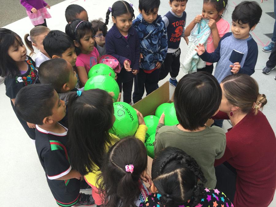 Big Smiles from soccerloco's Donation to Children's Bureau!