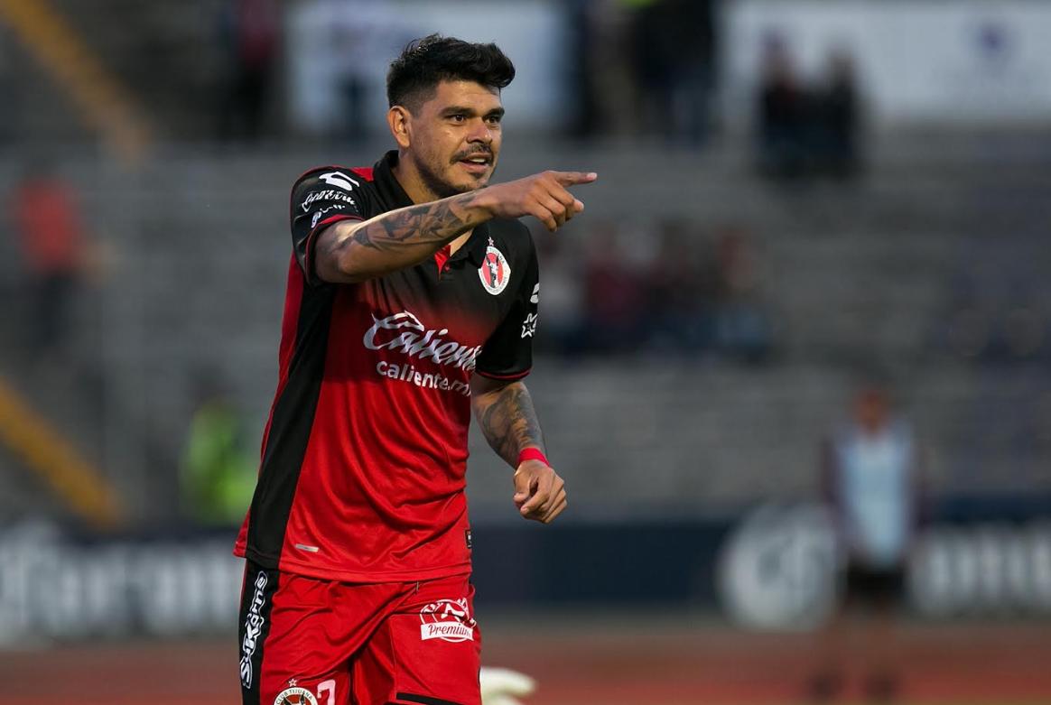 Lobos BUAP 1-2 Club Tijuana: Bou carries Xolos during Tuesday's bizarre Liga MX clash