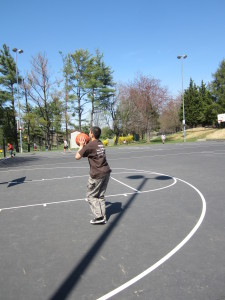 Teen playing basketball
