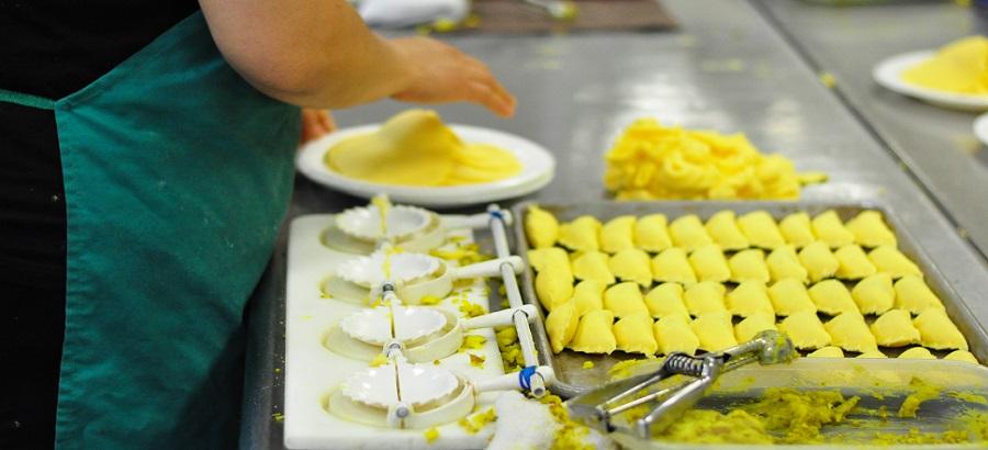 Tenant makes empanadas at WHEDco's Bronx CookSpace.