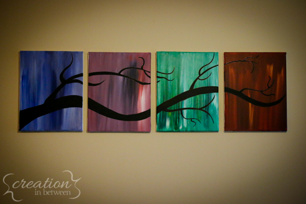 Close up of the four seasons tree paintings.