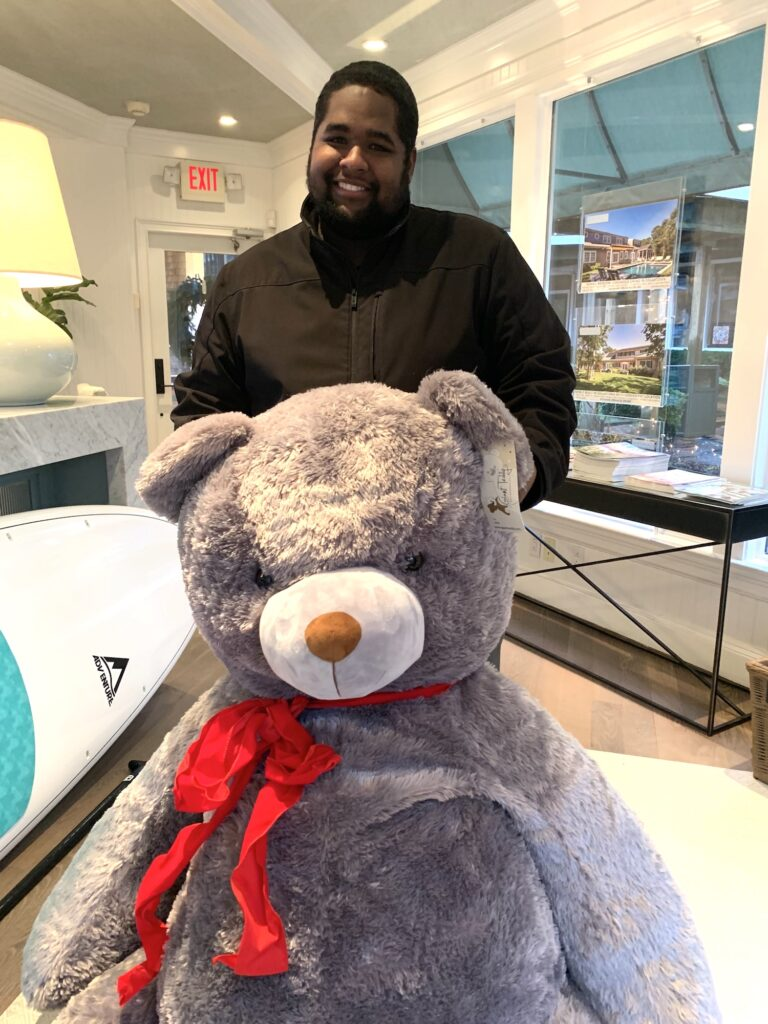 Martha's Vineyard Teddy Bear Suite Raffle Winner Ralston Francis picks up His Big Bear At The Point B Realty Office