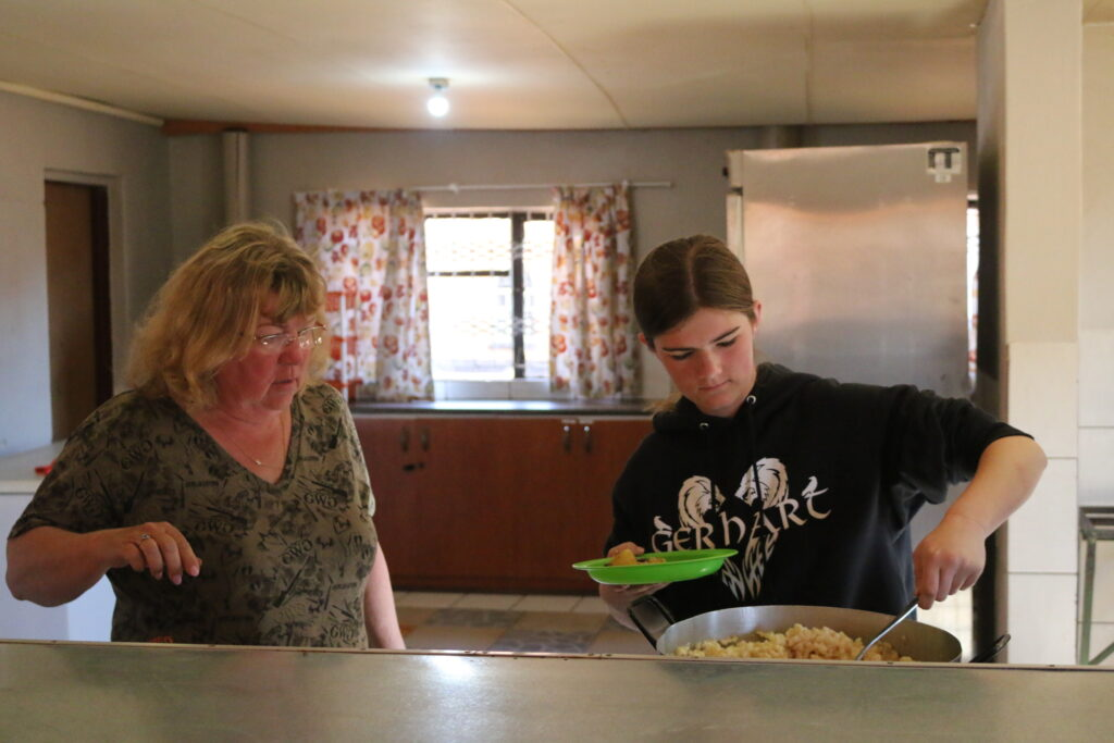 Mom and Shay dishing lunch