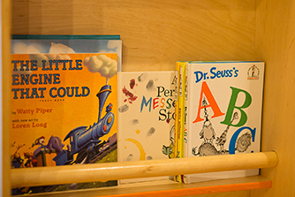 Children's books on a shelf
