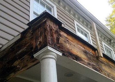 wood rot caused by leaky porch roof