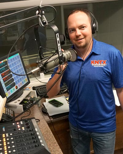 Chad Handsome of KNTX radio at the controls in the radio station