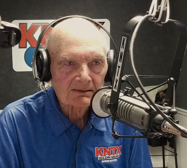 Lester Boyd at the microphone in the KNTX radio studio