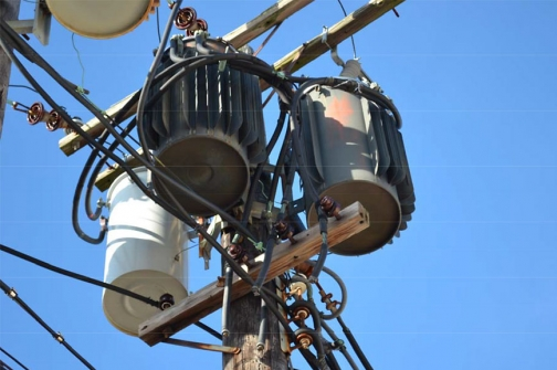 Overhead Utility Transformers that serve several buildings