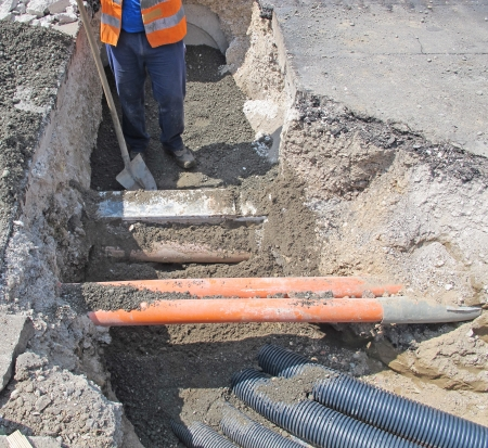 laying of optical fiber and electric cables in a roadworks project
