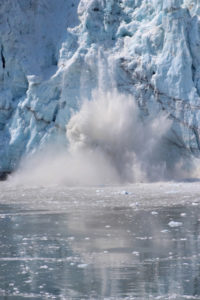ice breaking off of an ice berg