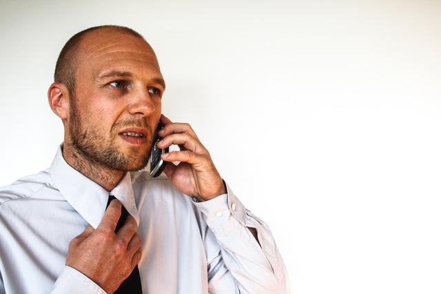 man on phone stressed