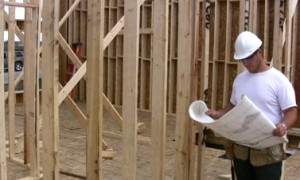 stock-footage-construction-worker-checking-the-plans-to-a-new-building