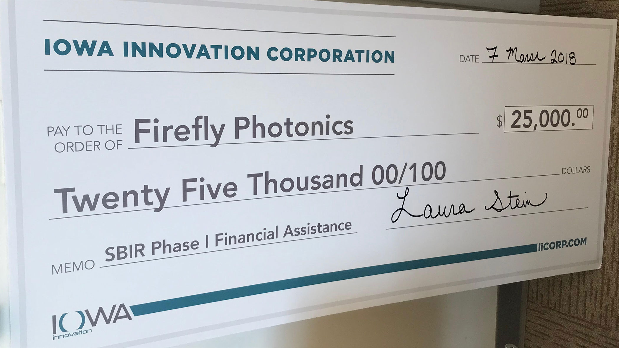 $25000 check to Firefly Photonoics