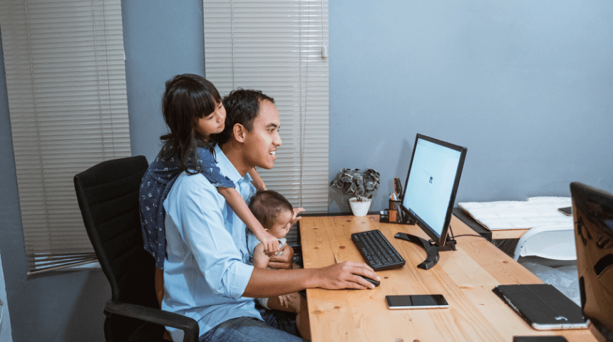 Man working from home with daughters on Techfullypro.com.