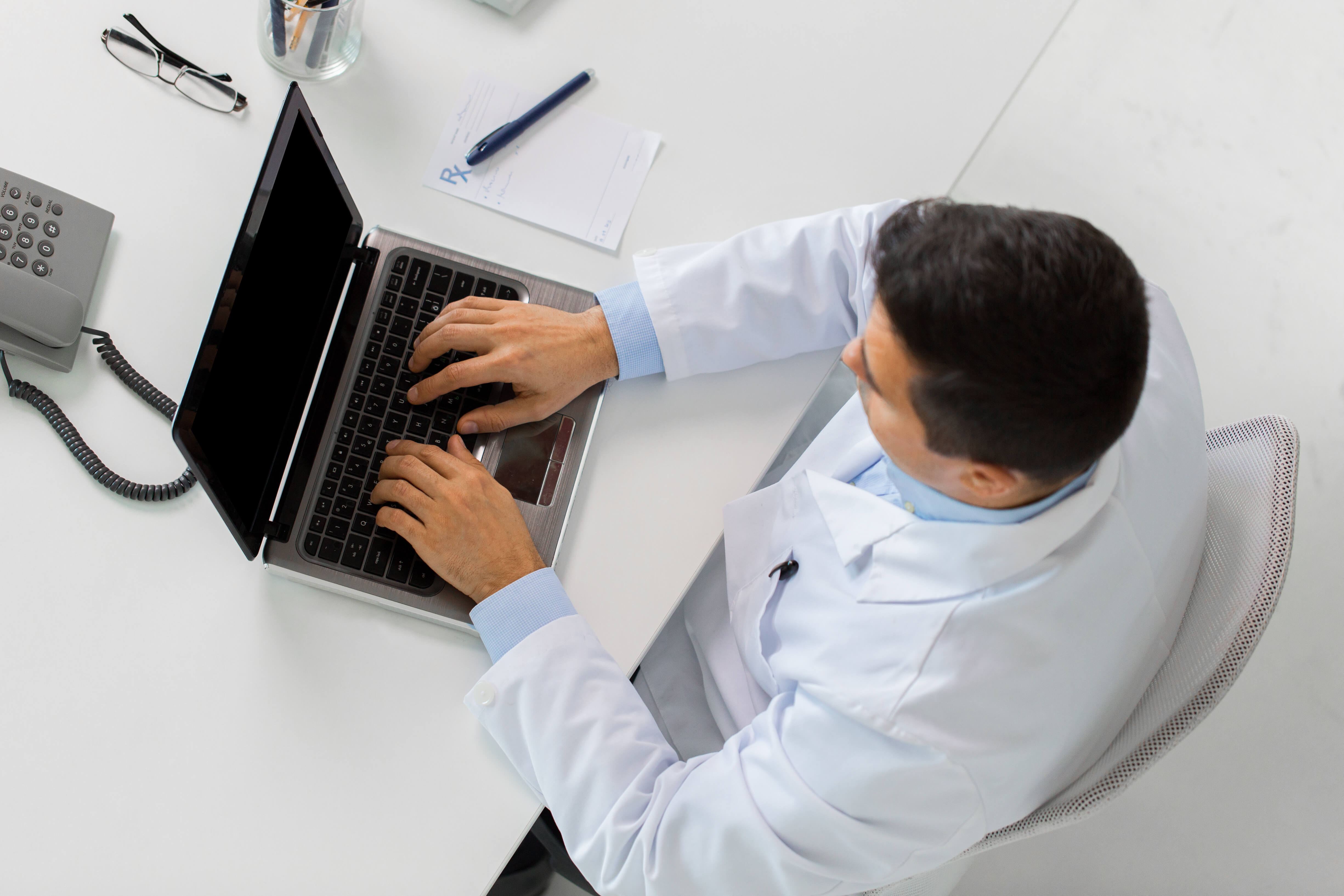 computer man phone pen white desk nurse triage jobs