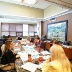team sitting desk art nurses jobs advice line remotely