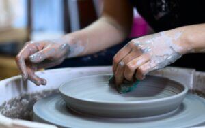person-making-clay-pot-1675993