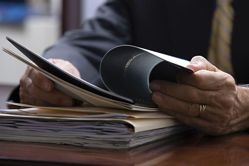 Businessman looking at paperwork cm