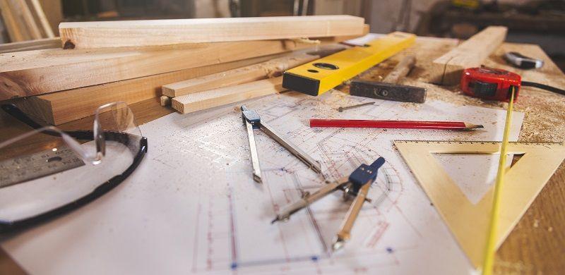 Carpenter tools on wooden background cm