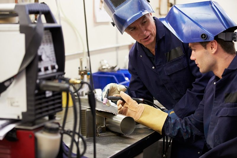 Engineer Teaching Apprentice To Use TIG Welding Machine cm