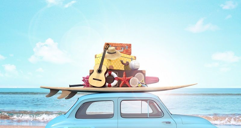 Car with luggage on the roof ready for summer vacation cm