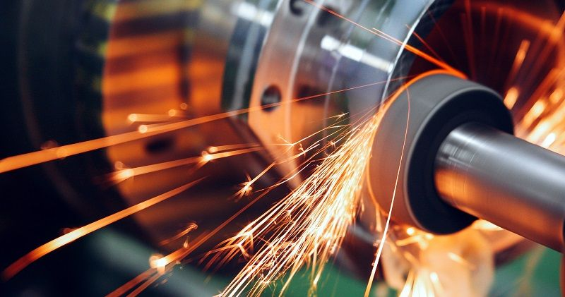sparks flying while machine griding and finishing metal-cm