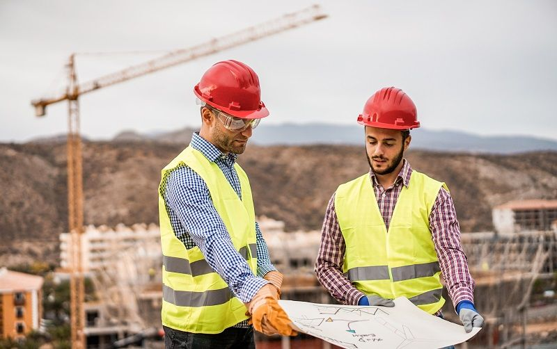 Builders-on-residential-construction-site-looking-the-building-project-cm