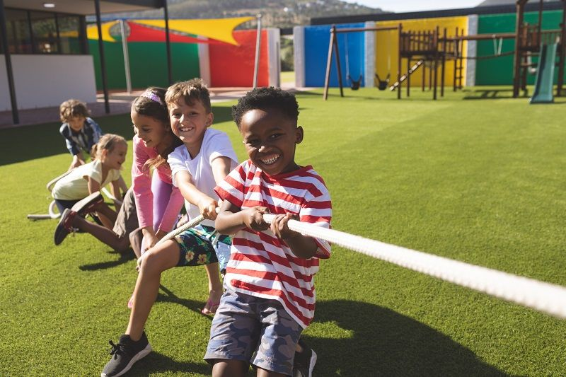 Group-of-school-kids-playing-tug-of-war-cm