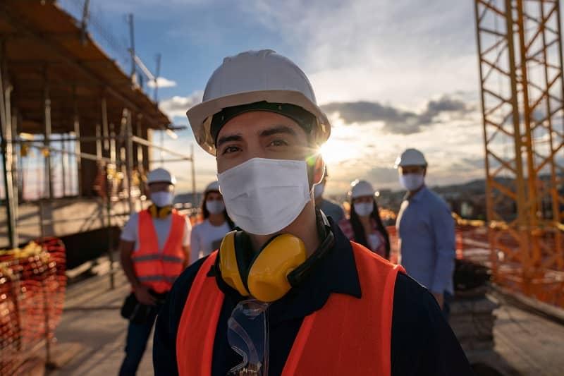 Portrait of a happy construction worker at a building site-cm