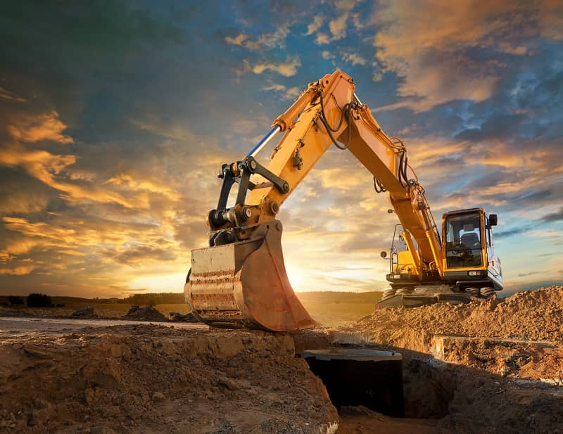 Excavator at a construction site against the setting sun-cm
