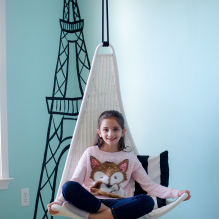 Sensory room girl in swing