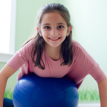 Sensory spaces girl on yoga ball