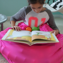 Sensory girl reading on ball bag