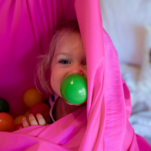 Sensory room baby with ball in mouth
