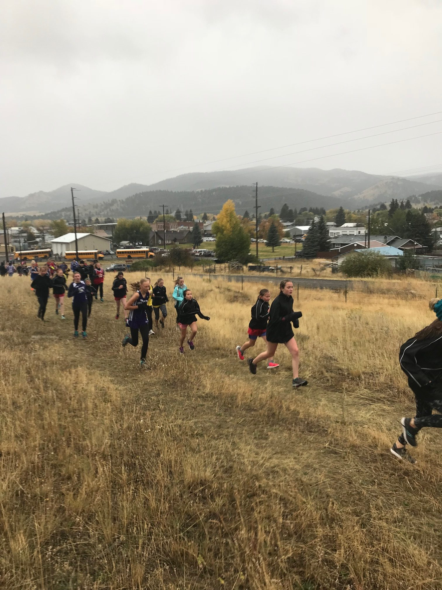 Providing race course assistance at daughter's cross country meet Brrr October running in Montana