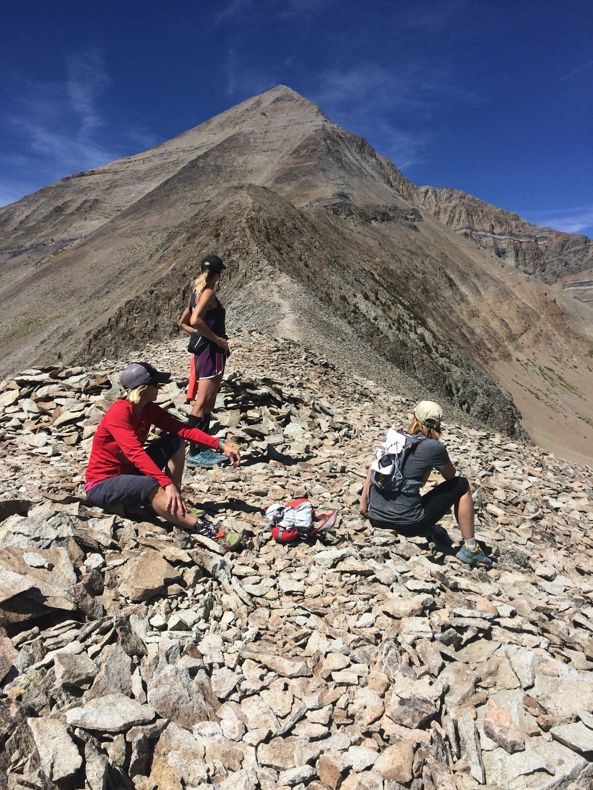 Taking a break before the ascent to Lone Peak Big Sky